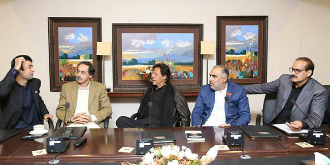 ISLAMABAD, DEC 07: Chairman PTI, Imran Khan presiding over a meeting at Bani Gala, on Thursday.=DNA PHOTO